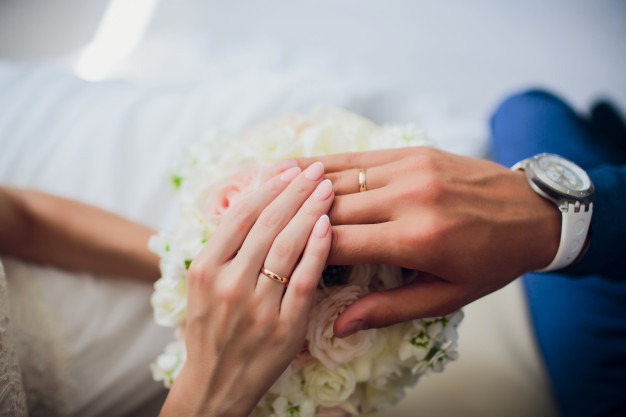 groom-brides-hands-with-rings-closeup-view_152904-3590
